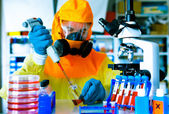 Test a vaccine against Ebola infection, a scientist in protectiv — Stock Photo