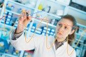 Laboratory assistant draws  graph — Stock Photo