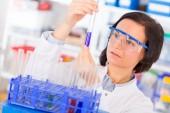 Woman holding test tube — Stock Photo