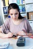Girl using a multimeter — Stock Photo