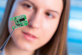 Girl showing new microchip — Foto Stock