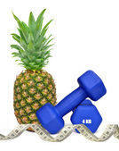 Blue fitness dumbbells with pineapple — Stockfoto