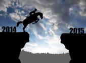 The rider on the horse jumping into the New Year 2015 — Stock Photo
