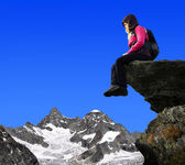 Girl sitting on a rock - Swiss Alps, Europe — Stock Photo