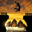 Girl jumps to the New Year 2015 — Stock Photo #58344599