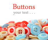 Pile of colorful plastic buttons — Stock Photo