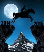 The rider on the horse jumping into the New Year 2015. — Stock Photo