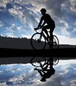Cyclist riding a road bike — Stock Photo