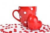 Red mug and heart — Stock Photo