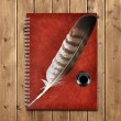 Notebook and feather with ink bottle — Stock Photo #71709417