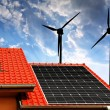 Solar panel on the roof of the house and wind turbines — Stock Photo #73760135