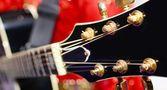 Black electric guitar headstock — Stock Photo