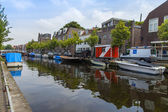 Haarlem, Netherlands, on July 11, 2014. A typical urban view with old buildings on the bank of the channel. — Stock Photo