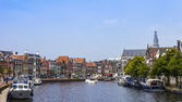 Haarlem, Netherlands, on July 11, 2014. Typical urban view with old buildings on the bank of the channel. — Stock Photo