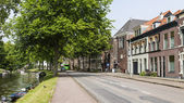 Haarlem, Netherlands, on July 11, 2014. Typical urban view with old buildings on the bank of the channel — Stock Photo