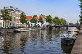 Haarlem, Netherlands, on July 11, 2014. Typical urban view with old buildings on the bank of the channel — Foto Stock