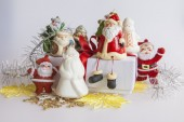 New Year's gift in a white cardboard box, jewelry for a fir-tree and the burning candle — Stock Photo
