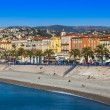 Nice, France, on October 16, 2012. View of the English promenade (Promenade des Anglais) and beach. Promenade des Anglais in Nice - one of the most beautiful and known embankments in Europe — Stock Photo #53843179
