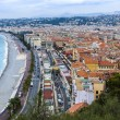 Nice, France, on October 16, 2012. View of the English promenade (Promenade des Anglais) and beach. Promenade des Anglais in Nice - one of the most beautiful and known embankments in Europe — Stock Photo #53935591