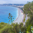 Nice, France, on October 16, 2012. View of the English promenade (Promenade des Anglais) and beach. Promenade des Anglais in Nice - one of the most beautiful and known embankments in Europe — Stock Photo #53935593