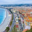 Nice, France, on October 16, 2012. View of the English promenade (Promenade des Anglais) and beach. Promenade des Anglais in Nice - one of the most beautiful and known embankments in Europe — Stock Photo #53935595