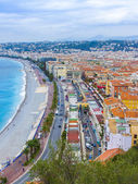 Nice, France, on October 16, 2012. View of the English promenade (Promenade des Anglais) and beach. Promenade des Anglais in Nice - one of the most beautiful and known embankments in Europe — Stock Photo