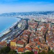 Nice, France, on October 16, 2012. View of the English promenade (Promenade des Anglais) and beach. Promenade des Anglais in Nice - one of the most beautiful and known embankments in Europe — Stock Photo #54131463