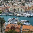 Nice, France, on October 16, 2012. View of city port and the house on the embankment from a high point — Stock Photo #54164427