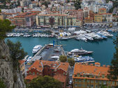 Nice, France, on October 16, 2012. View of city port and the house on the embankment from a high point — Stockfoto
