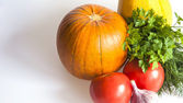 Orange pumpkin, tomato, garlic and garlic for salad — Stock Photo