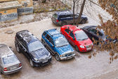 Pushkino, Russia, on November 17, 2014. The first snow in the city. Cars stand on a parking in the inhabited massif — Stock Photo