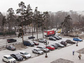 Pushkino, Russia, on December 1, 2014. A blizzard at the beginning of winter. The parking in the inhabited residential district brought by snow — Stock Photo