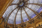 Paris, France, on April 30, 2013. A glass dome in modernist style of the flagman Gallery shop Lafayette, the author Jacques Gruber. — Stockfoto