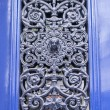 Paris, France, on March 25, 2011. Architectural details. The door of the old house decorated with an openwork ornament — Stock Photo #60455317