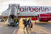 Berlin, Germany, on March 23, 2011. Passengers go down on a plane ladder (AirBerlin airline) at the airport Tegel — Stock Photo