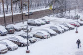 Pushkino, Russia, on December 21, 2014. A blizzard at the beginning of winter. The parking in the inhabited residential district brought by snow — Stock Photo
