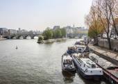 Paris, France, on March 29, 2011. Typical city landscape. A view of Seine, its embankments and the moored inhabited ships. — Stock Photo
