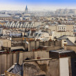 Постер, плакат: Paris France on March 27 2011 A view of city roofs from survey gallery of the Centre Georges Pompidou