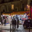 Paris, France, on March 26, 2011. Tourists walk on the evening street on Montmartre — Stock Photo #61392035