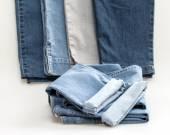 The jeans of various shades on a counter — Stock Photo