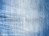 Texture of threadbare denim of indigo color — Stock Photo