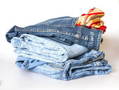 Jeans of indigo color on a show-window of shop — Stock Photo