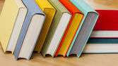 Vintage books in multi-colored covers on a table — Foto de Stock