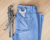 Blue jeans and vintage sanitary tools — Stock Photo