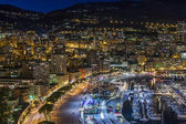 Principality of Monaco, France, on October 16, 2012. A night view of the port and residential areas on a slope of mountains — Stockfoto