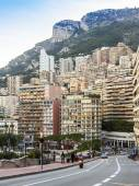 Principality of Monaco, France, on October 16, 2012. A view of the port and residential areas on a slope of mountains at sunset — Stock Photo