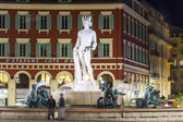 Nice, France, on March 13, 2015. The fountain on Massena Square in evening illumination. Massena Square is the downtown — Stock Photo