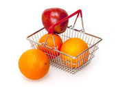 Bright large oranges in a basket for shopping — Stock Photo