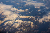 View of a massif from a window of the flying plane — Stock Photo