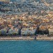 Nice, France, on March 7, 2015. The top view from a window of the flying plane on Promenade des Anglais lit with beams of the sunset sun — Stock Photo #69283397